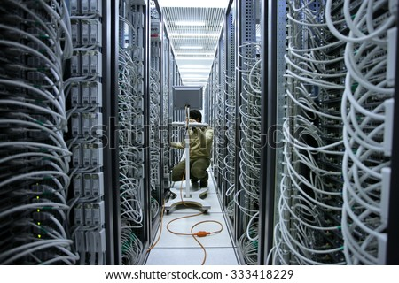 Milan, Italy - October 27, 2015 : Network modern server room with computers for digital communications and internet - stock photo
