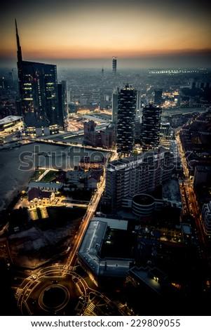 Milan, Italy october 26 2014: new Porta Garibaldi financial district from  Regione Lombardia skyscraper, floor 39, at dusk,  Milan, Italy, october 26 2014 - stock photo