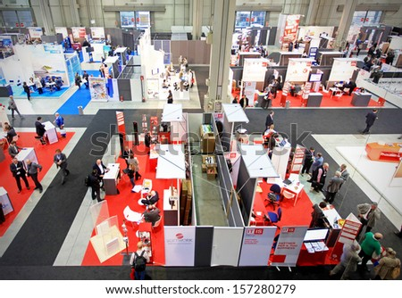 MILAN, ITALY - OCTOBER 17: Panoramic view of technology products exhibition area at SMAU, international fair of business intelligence and information technology October 17, 2012 in Milan, Italy.  - stock photo