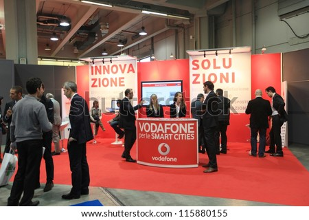 MILAN, ITALY - OCTOBER 17: People at Vodafone technologies products area at SMAU, international fair of business intelligence and information technology October 17, 2012 in Milan, Italy. - stock photo