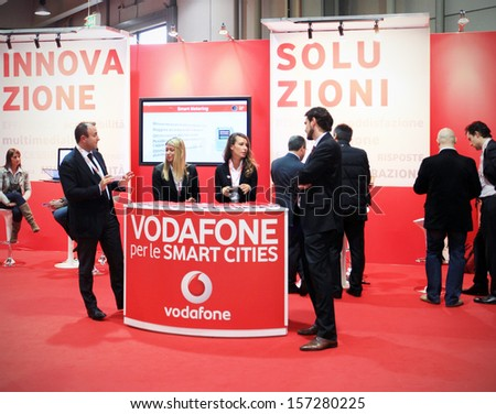 MILAN, ITALY - OCTOBER 17: People at Vodafone technologies products exhibition area at SMAU, international fair of business intelligence and information technology October 17, 2012 in Milan, Italy.  - stock photo