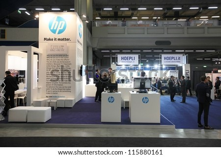 MILAN, ITALY - OCTOBER 17: People visit HP technologies products area at SMAU, international fair of business intelligence and information technology October 17, 2012 in Milan, Italy. - stock photo