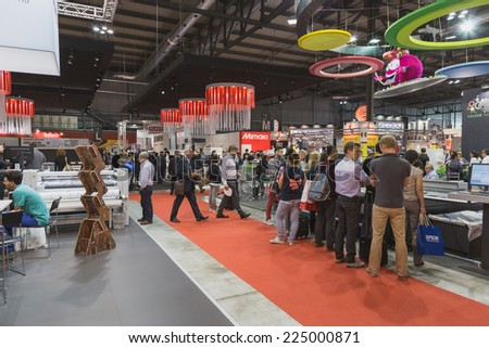 MILAN, ITALY - OCTOBER 17: People visit Viscom, international trade fair and conference on visual communication and event services on OCTOBER 17, 2014 in Milan. - stock photo