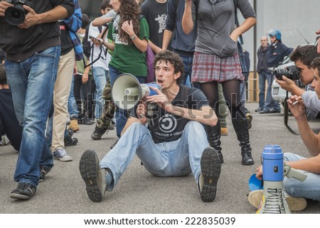 MILAN, ITALY - OCTOBER 10: Students inside the education agency building protest against money cuts in the public school on OCTOBER 10, 2014 in Milan. - stock photo