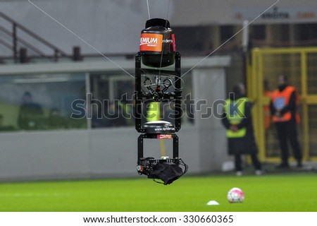 MILAN, ITALY-OCTOBER 18, 2015: television drone camera during the italian professional soccer match FC Internazionale vs FC Juventus, at San Siro stadium, in Milan. - stock photo