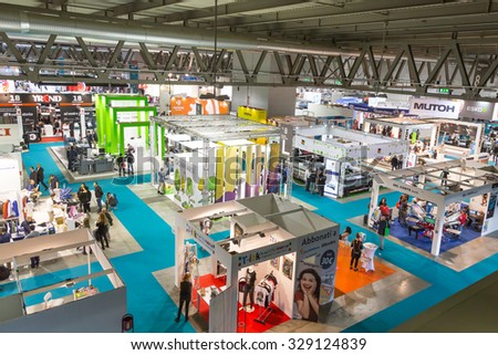 MILAN, ITALY - OCTOBER 16: Top view of booths and people at Viscom, international trade fair and conference on visual communication and event services on OCTOBER 16, 2015 in Milan. - stock photo