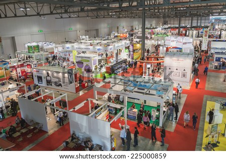 MILAN, ITALY - OCTOBER 17: Top view of people and booths at Viscom, international trade fair and conference on visual communication and event services on OCTOBER 17, 2014 in Milan. - stock photo