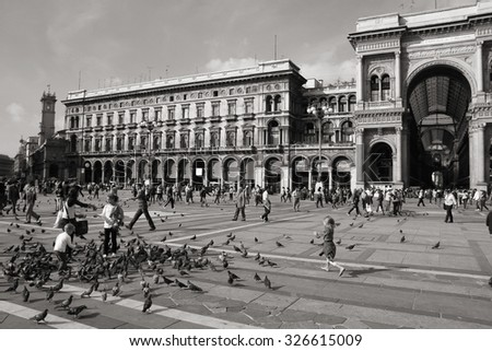 MILAN, ITALY - OCTOBER 6, 2010: Tourists visit Piazza Duomo in Milan, Italy. As of 2006, Milan was the 42nd most visited city worldwide, with 1.9 million annual international visitors. - stock photo