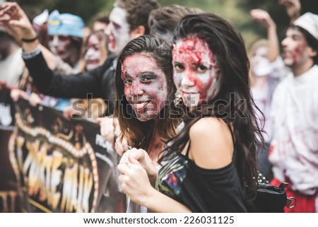 MILAN, ITALY - OCTOBER 25: Zombie parade held in Milan October 25, 2014. People took to the streets of Milan masked as zombie monsters for the next halloween holiday. - stock photo
