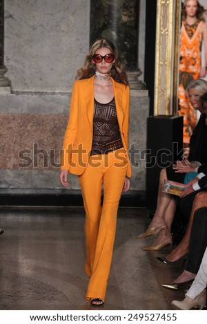 MILAN, ITALY - SEPTEMBER 20: A model walks the runway at the Emilio Pucci show as a part of Milan Fashion Week Womenswear Spring/Summer 2015 on September 20, 2014 in Milan, Italy. - stock photo