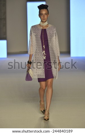 MILAN, ITALY - SEPTEMBER 19: A model walks the runway during the Aigner show as a part of Milan Fashion Week Womenswear Spring/Summer 2015 on September 19, 2014 in Milan, Italy. - stock photo