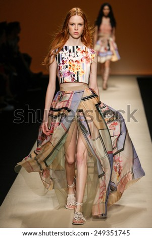 MILAN, ITALY - SEPTEMBER 17: a model walks the runway during the Alberta Ferretti show as part of Milan Fashion Week Womenswear Spring/Summer 2015 on September 17, 2014 in Milan, Italy. - stock photo
