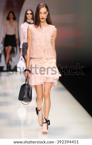 MILAN, ITALY - SEPTEMBER 25: A model walks the runway during the Emporio Armani show as a part of Milan Fashion Week Spring/Summer 2016 on September 25, 2015 in Milan, Italy.  - stock photo