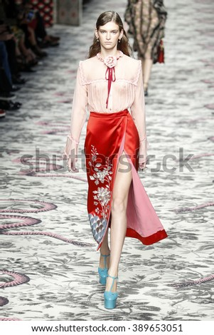 MILAN, ITALY - SEPTEMBER 23: A model walks the runway during the Gucci show as a part of Milan Fashion Week Spring/Summer 2016 on September 23, 2015 in Milan, Italy.  - stock photo