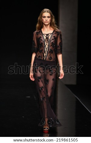MILAN, ITALY - SEPTEMBER 21: A model walks the runway during the John Richmond show as part of Milan Fashion Week Womenswear Spring 2015 on September 21, 2014 in Milan, Italy. - stock photo