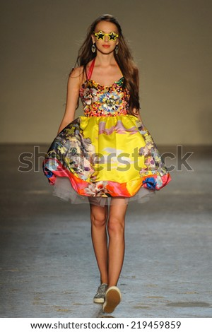 MILAN, ITALY - SEPTEMBER 18: A model walks the runway during the Leitmotiv show as a part of Milan Fashion Week Womenswear Spring 2015 on September 18, 2014 in Milan, Italy.
