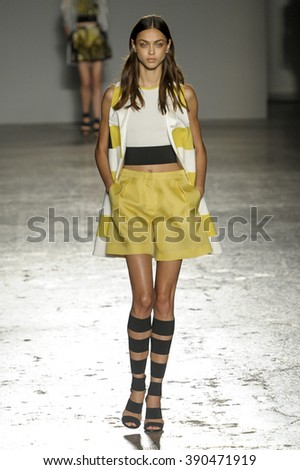 MILAN, ITALY - SEPTEMBER 23: A model walks the runway during the Les Copains fashion show as part of Milan Fashion Week Spring/Summer 2016 on September 23, 2015 in Milan, Italy. - stock photo