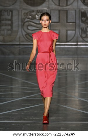 MILAN, ITALY - SEPTEMBER 20: A model walks the runway during the Mila Schon show as part of Milan Fashion Week Womenswear Spring-Summer 2015 on September 20, 2014 in Milan, Italy. - stock photo