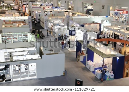 MILAN, ITALY - SEPTEMBER 09: Aerial view of people visiting architecture and interior design exposition at Macef, International Home Show Exhibition on September 09, 2011 in Milan, Italy. - stock photo