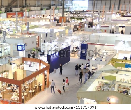 MILAN, ITALY - SEPTEMBER 09: Aerial view of people visiting architecture and interior design exposition at Macef, International Home Show Exhibition on September 09, 2011 in Milan, Italy.