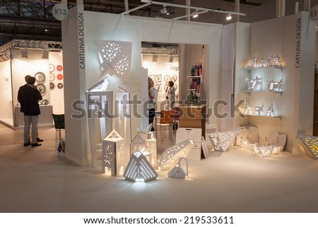 MILAN, ITALY - SEPTEMBER 13: Cartuna design stand at HOMI, home international show and point of reference for all those in the sector of interior design on SEPTEMBER 13, 2014 in Milan. - stock photo