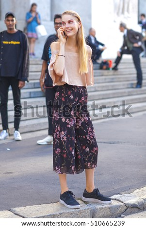 MILAN, ITALY - SEPTEMBER 27: Fashionable woman poses after FERRAGAMO fashion show during Milan Women's Fashion Week Day 5, street style on SEPTEMBER 27, 2016 in Milan.