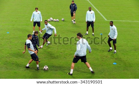 MILAN, ITALY-SEPTEMBER 15, 2009: FC Barcelona soccer players warm up during UEFA Champions League league at the san siro soccer stadium, in Milan. - stock photo