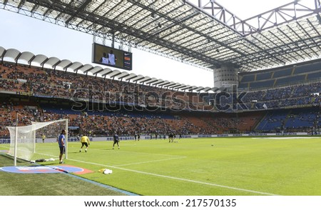 MILAN, ITALY-SEPTEMBER 14, 2014: goalkeeper training on the soccer pitch of San Siro stadium, before the Serie A professional soccer match Inter vs Sassuolo, in Milan.