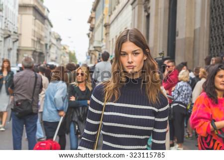 MILAN, ITALY - SEPTEMBER 27: Gorgeous model outside Trussardi fashion show building for Milan Women's Fashion Week on SEPTEMBER 27, 2015  in Milan. - stock photo