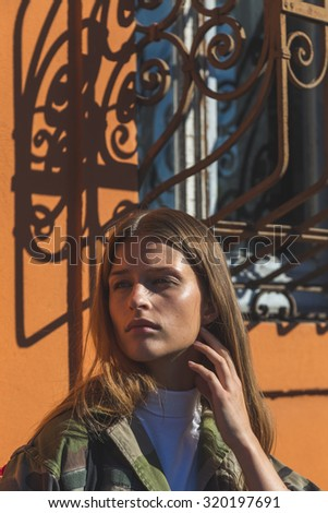 MILAN, ITALY - SEPTEMBER 24: Gorgeous model poses outside Pucci fashion show building for Milan Women's Fashion Week on SEPTEMBER 24, 2015  in Milan. - stock photo