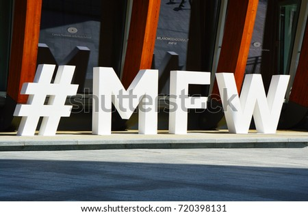 MILAN, ITALY - SEPTEMBER 22, 2017: Milan Fashion Week logo #MFW. Milan Fashion Week is a clothing trade show held semi-annually in Milan, Italy