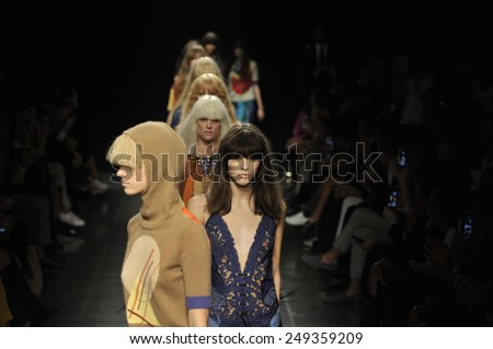 MILAN, ITALY - SEPTEMBER 18: Models walk the runway at the Angelo Marani - Show during Milan Fashion Week Womenswear Spring 2015 on Septmber 18, 2014 in Milan, Italy.