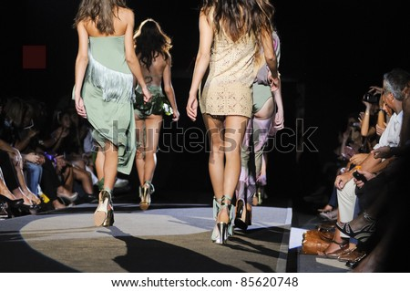 MILAN, ITALY - SEPTEMBER 25: Models walk the runway at woman fashion week in Milan, Italy on September, 25 2011. This is a fashion show of the collection AGOGOA which brings together famous and beautiful Italian women - stock photo