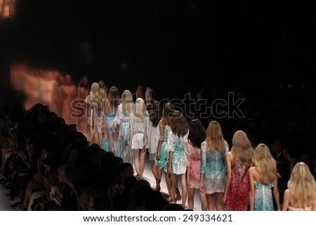 MILAN, ITALY - SEPTEMBER 19: Models walk the runway during the Blumarine show as a part of Milan Fashion Week Womenswear Spring/Summer 2015 on September 19, 2014 in Milan, Italy - stock photo