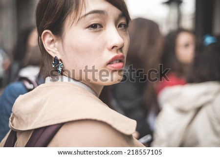MILAN, ITALY - SEPTEMBER 20: People during Milan Fashion week in Milan, Italy on September, 20 2014. Eccentric and fashionable people in the city during fashion week wait for models and famous people