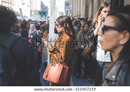 MILAN, ITALY - SEPTEMBER 24: People during Milan Fashion week, Italy on SEPTEMBER 24, 2015. Eccentric and fashionable chatting while waiting for models and vips outside city during Milan fashion week - stock photo