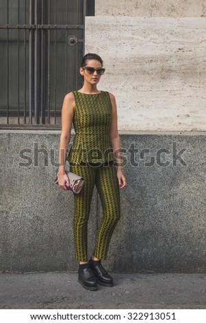 MILAN, ITALY - SEPTEMBER 27: People gather outside Ferragamo fashion show building for Milan Women's Fashion Week on SEPTEMBER 27, 2015  in Milan. - stock photo