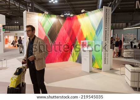 MILAN, ITALY - SEPTEMBER 13: People visit HOMI, home international show and point of reference for all those in the sector of interior design on SEPTEMBER 13, 2014 in Milan.