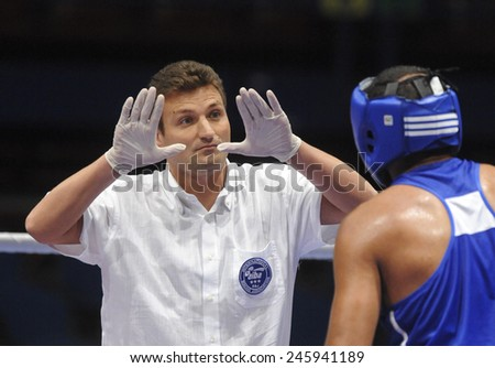 MILAN, ITALY-SEPTEMBER 09, 2009: referee and amateur boxer during a boxe match of the World Boxing Championship, in Milan.