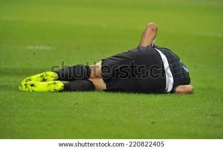 MILAN, ITALY-SEPTEMBER 24,2014: soccer player laying on the grass after an injury, during the serie A match FC Internazionale vs Atalanta at the San Siro stadium, in Milan.  - stock photo