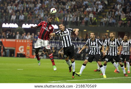 MILAN, ITALY-SEPTEMBER 20, 2014: soccer players Cristian Zapata and Leonardo Bonucci in action at the San Siro stadium, during the professional serie A soccer match AC Milan vs Juventus, in Milan. - stock photo