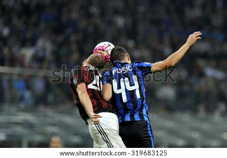 MILAN, ITALY-SEPTEMBER 13, 2015: soccer players Ivan Perisic and Ignazio Abate in action during the milanese derby FC Internazionale vs AC Milan at the San Siro stadium, in Milan.