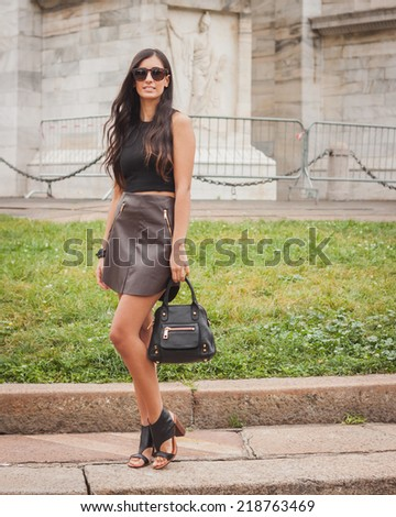 MILAN, ITALY - SEPTEMBER 20: Woman poses outside Cavalli fashion shows building for Milan Women's Fashion Week on SEPTEMBER 20, 2014 in Milan.