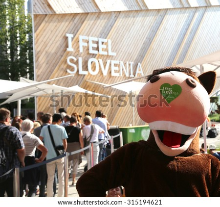 Milan, Italy - 8th September, 2015. Expo Milan 2015 Universal Exposition. Cute horse mascot of Slovenia Pavilion with adhesive and slogan