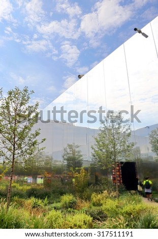 Milan,Italy - 8th September, 2015. Expo Milan 2015 Universal Exposition. Fabulous garden with trees and mirrors under the blue sky on the roof of the Polish Pavilion