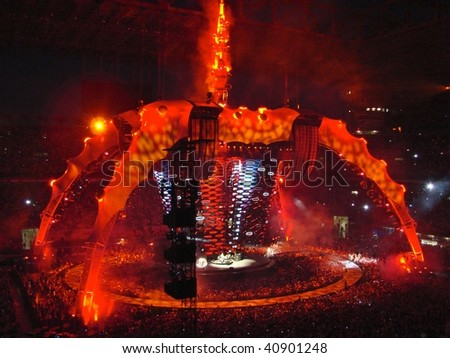 MILAN -  JULY 8: U2 rock band perform during the U2 360° Tour concert on 8 July, 2009 in Milan, Italy. - stock photo
