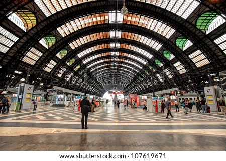 MILAN - JUNE 07: Milan Central Station interior view. It was opened in 1931, serves national and international routes and is one of the main European railway stations in Milan, Italy on June 07, 2012. - stock photo