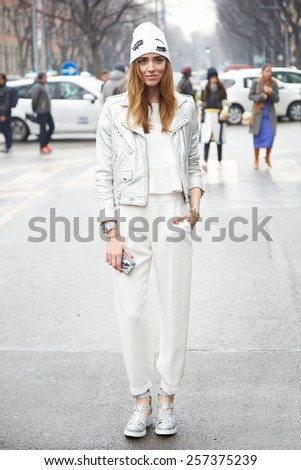 MILAN - MARCH 2: Chiara Ferragni poses for photographers before Giorgio Armani show , Milan Fashion Week Day 6, Fall/Winter 2015/2016 street style on March 2, 2015 in Milan. - stock photo