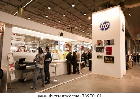 MILAN - MARCH 25: HP stand at Photoshow 2011 in Milan Fair on March 25, 2011 in Milan, Italy. This year Photoshow hosts about 300 exhibitors of all the most important firms of the photography business - stock photo
