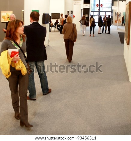 MILAN - MARCH 27: Looking at paintings and sculpture work of arts galleries during MiArt ArtNow, international exhibition of modern and contemporary art March 27, 2010 in Milan, Italy. - stock photo